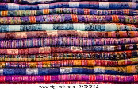 Stack Of Colorful Fabrics At Market
