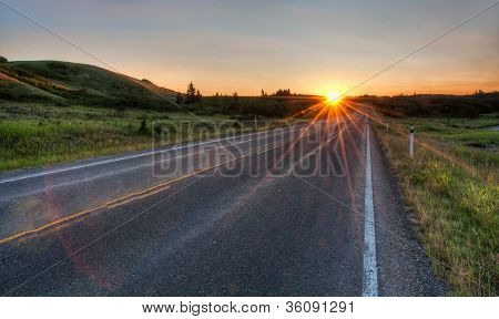 Road Vanishing To Distance With Sun Star