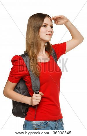 Young female with backpack looking forward
