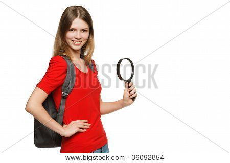 Teenager with backpack holding magnifying glass