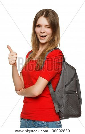 Happy teenager with backpack winking