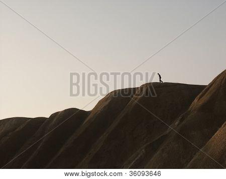 Man Walking Down A Hill