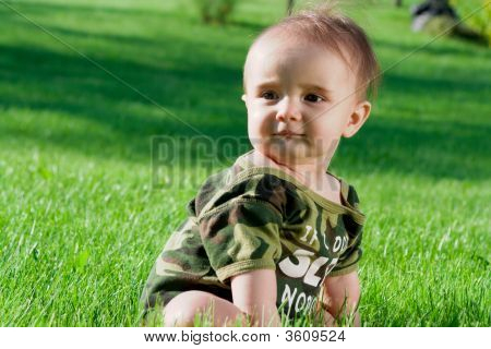 Baby Sitting On A Grass