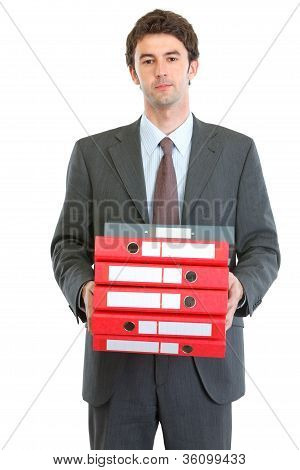 Modern Businessman Holding Pack Of Folders
