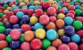 pic of gumballs  - large group of gumballs on concrete floor - JPG