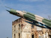 pic of fulcrum  - MIG plane bombing civil house in the war - JPG