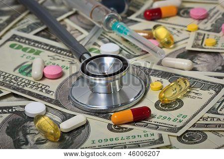 Stethoscope With Syringe On U.s. Dollar Banknotes