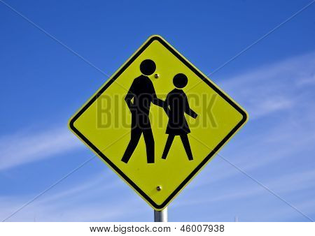 Road sign people crossing