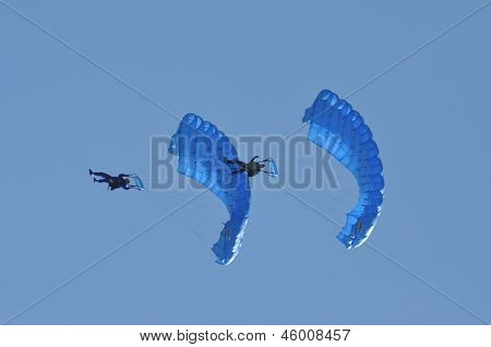 Parachutists jumping and flying in the air