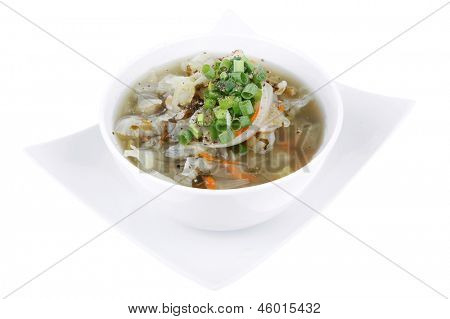 diet food : vegetable soup topped with green  onion in white bowl isolated over white background