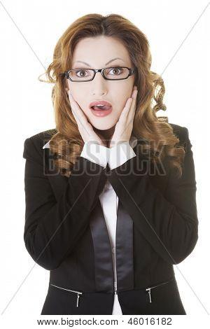 Shocked businesswoman, isolated on white