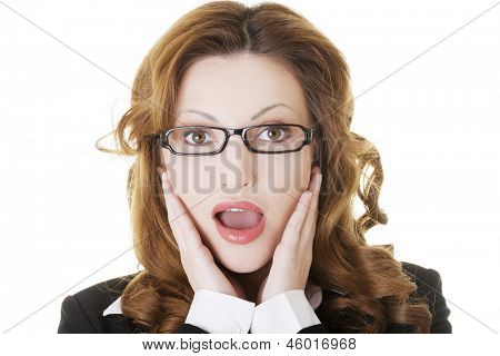 Shocked businesswoman, isolated on white