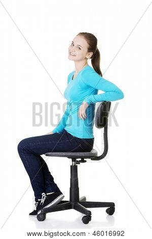 Young happy student woman or businesswoman sitting on a wheel chair, isolated over a white background