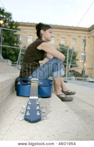 Woman Guitarist Relaxing
