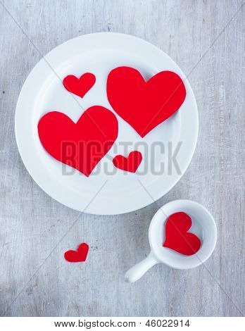 Big And Small Hearts On The White China Dishes