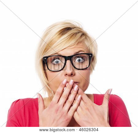 Surprised woman covering her mouth