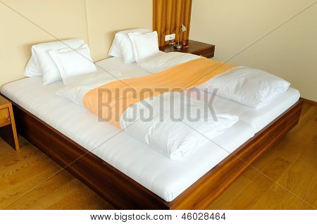 Modern wooden bed in hotel