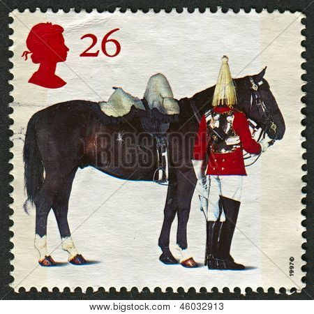 "UK - CIRCA 1997: A stamp printed in UK shows image of the Lifeguards Horse and Trooper,""'All The Queens Horses"". 50th Anniversary of the British Horse Society, circa 1997."
