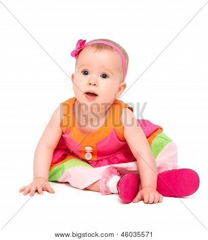 Surprised, Sad Little Baby Girl In Bright Multicolored Festive Dress Isolated