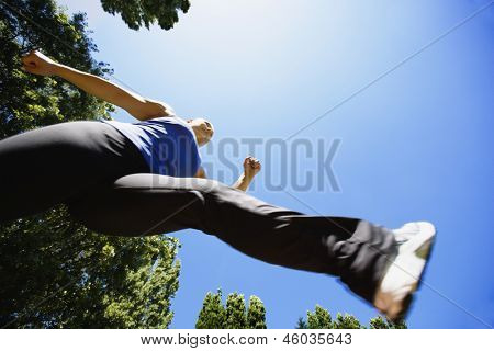 Low angle view of woman running