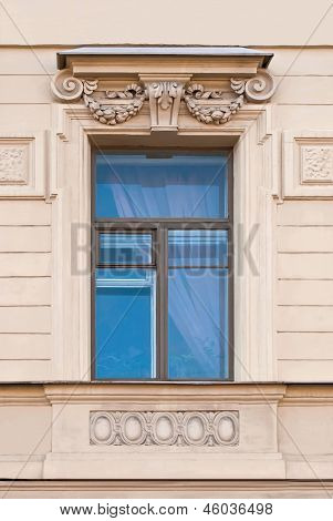 A window with a bas-relief.