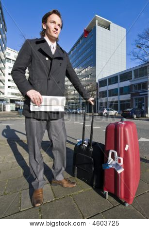 Businessman Waiting For A Taxi