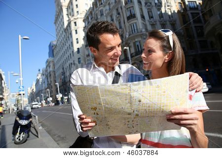 Couple of tourists in Gran Via avenue of Madrid