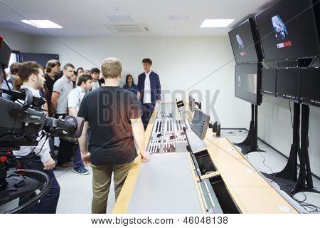 MOSCOW - AUGUST 15: Young producer Ilya Bachurin in room for mounting films in new cinema complex Glavkino, on August 15, 2012 in Moscow, Russia.