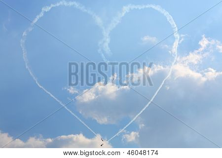 ZHUKOVSKY - AUGUST 12: Aircrafts paint big heart of smoke at airshow on 100th anniversary of Russian Air Force on August 12, 2012 in Zhukovsky, Moscow region, Russia.
