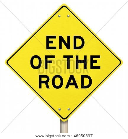 The words End of the Road on a yellow warning sign representing a dead-end street or a failed effort at success, signalling the final, last failure and an indicator of cancellation or termination
