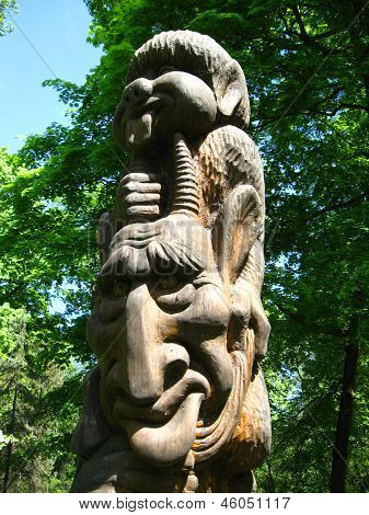 Sculpture Of Fabulous Personage From A Tree