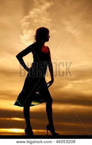 Woman Silhouette In Sunset Standing