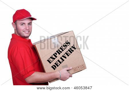 Young Delivery Man In Red Uniform Holding The Box