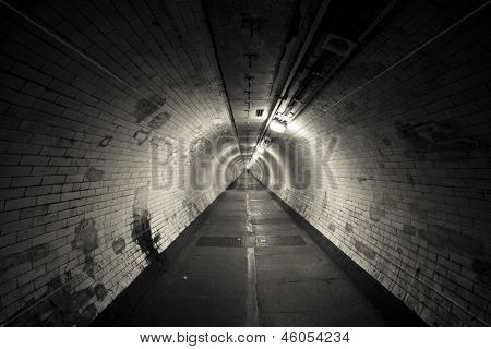 Empty tunnel at night - Light at the end of  tunnel  - Sepia Toning