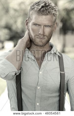 Outdoor portrait of a handsome young confident man