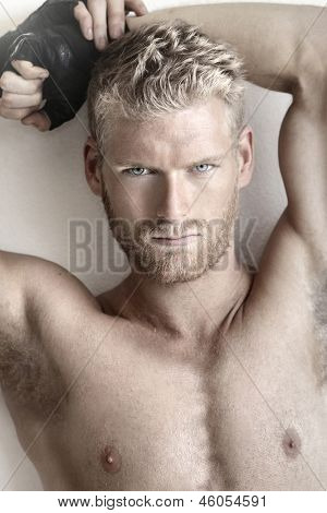 Highly detailed fashion portrait of a sexy muscular shirtless male model
