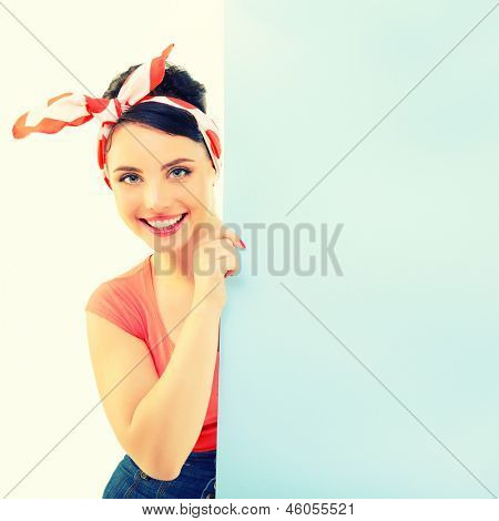 Pinup girl holding empty banner, portrait of young happy sexy woman in pin-up style, toned