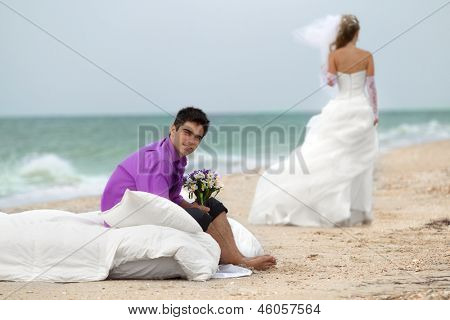 Wedding shot of  bride and groom on beach