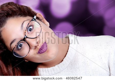 Portrait Of A Young Red Headed Girl In Glasses