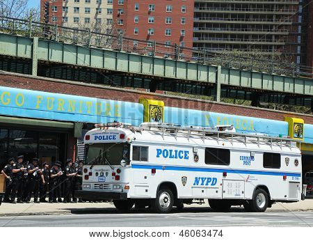 NYPD officers next to mobile command post  in Brooklyn, NY