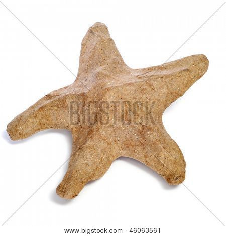 closeup of a paper-mache seastar on a white background