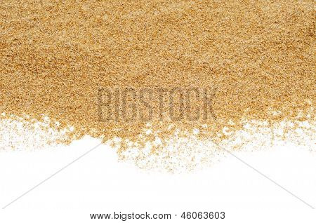 closeup of a pile of sand of a beach or a desert, on a white background