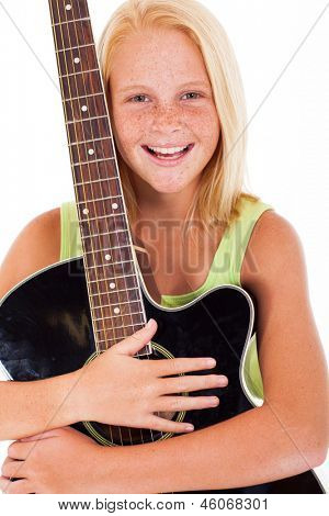 portrait of beautiful young preteen girl holding a guitar on white background