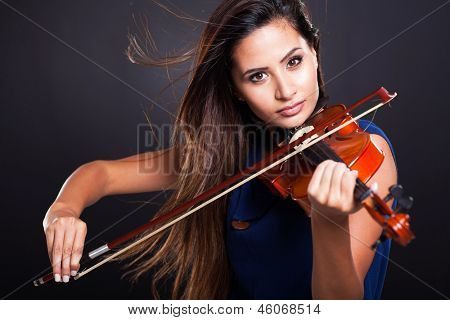 professional violinist on black background