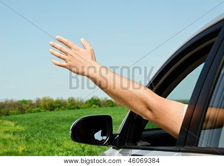 Man Inside Car Showing His Hand