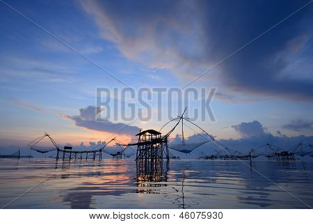 Silhouette Traditional Fishing Method Using A Bamboo Square Dip Net With Sunrise