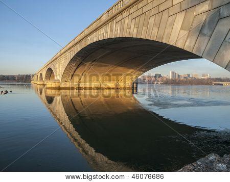 Dawn light on the Arlington bridge and Potomac river in Washington DC, USA.