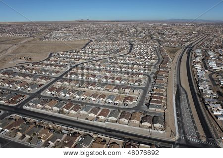 Aerial of modern residential neighborhoods in arid Albuquerque, New Mexico, USA.