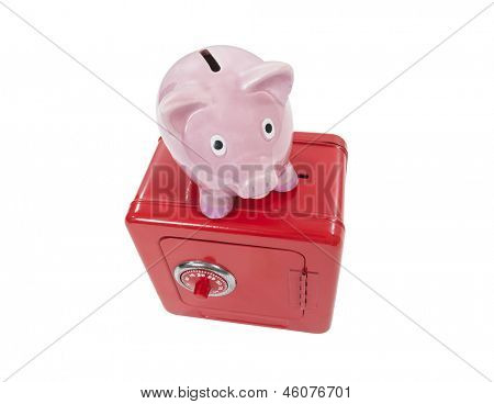 Vintage piggy bank and toy coin safe isolated with clipping path.