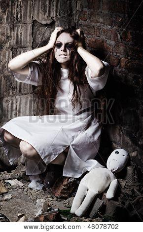 Horror Style Shot: Strange Crazy Girl And Her Moppet Doll